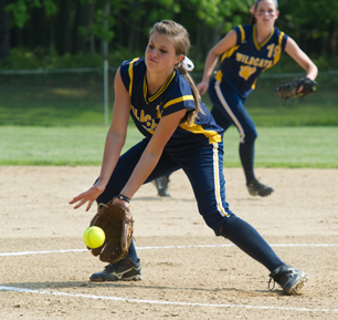 ROBERT O'ROURK PHOTO | Shoreham-Wading River pitcher Chelsea Hawks fields the grounder. She threw a complete game shuout to earn the win for the Wildcats.