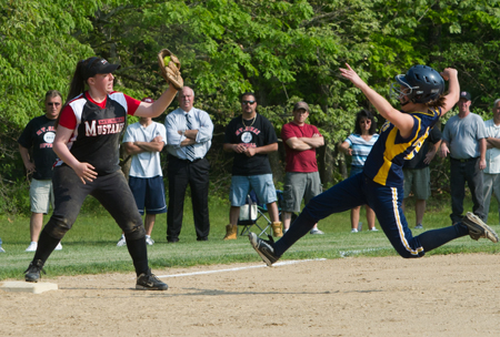 ROBERT O'ROURK PHOTO | Shoreham-Wading River right fielder Brittany Mahan was out at third as Mount Sinai third baseman Rebecca Gorman snags the throw on the force play.