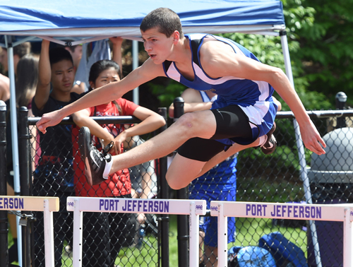 Riverhead's Ryan DiResta competes in the hurdles of the pentathlon. (Credit: Robert O'Rourk)