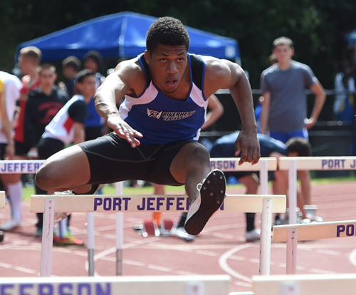 Riverhead's Andrew Smith competes in the 110-meter hurdles. (Credit: Robert O'Rourk)