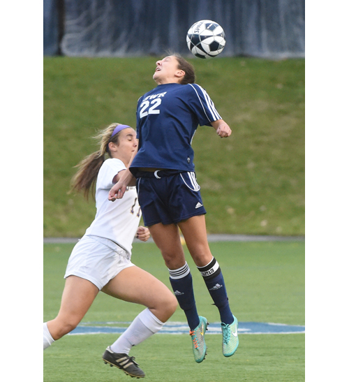 Emily Sopko heads the ball away from Emily McAuliff. (Credit: Robert O'Rourk)