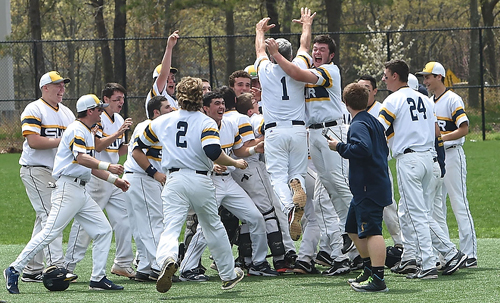 The Shoreham-Wading River Wildcats joined in celebration after defeating Bayport-Blue Point, 3-2, in extra innings and securing the League VII championship outright. (Credit: Robert O'Rourk)