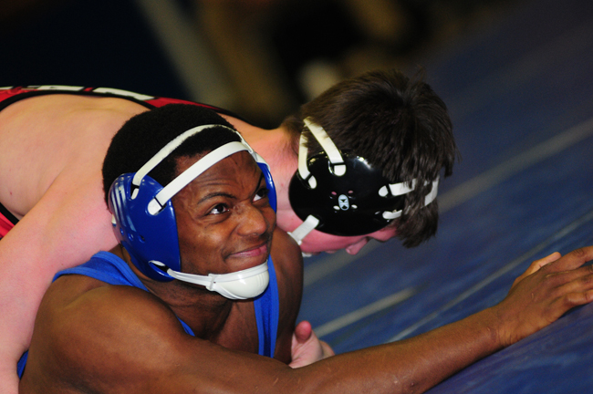 Riverhead's Raheem Brown won a 3-1 decision at 170 pounds against Hills East's Griffin Arcuri. (Credit: Bill Landon)