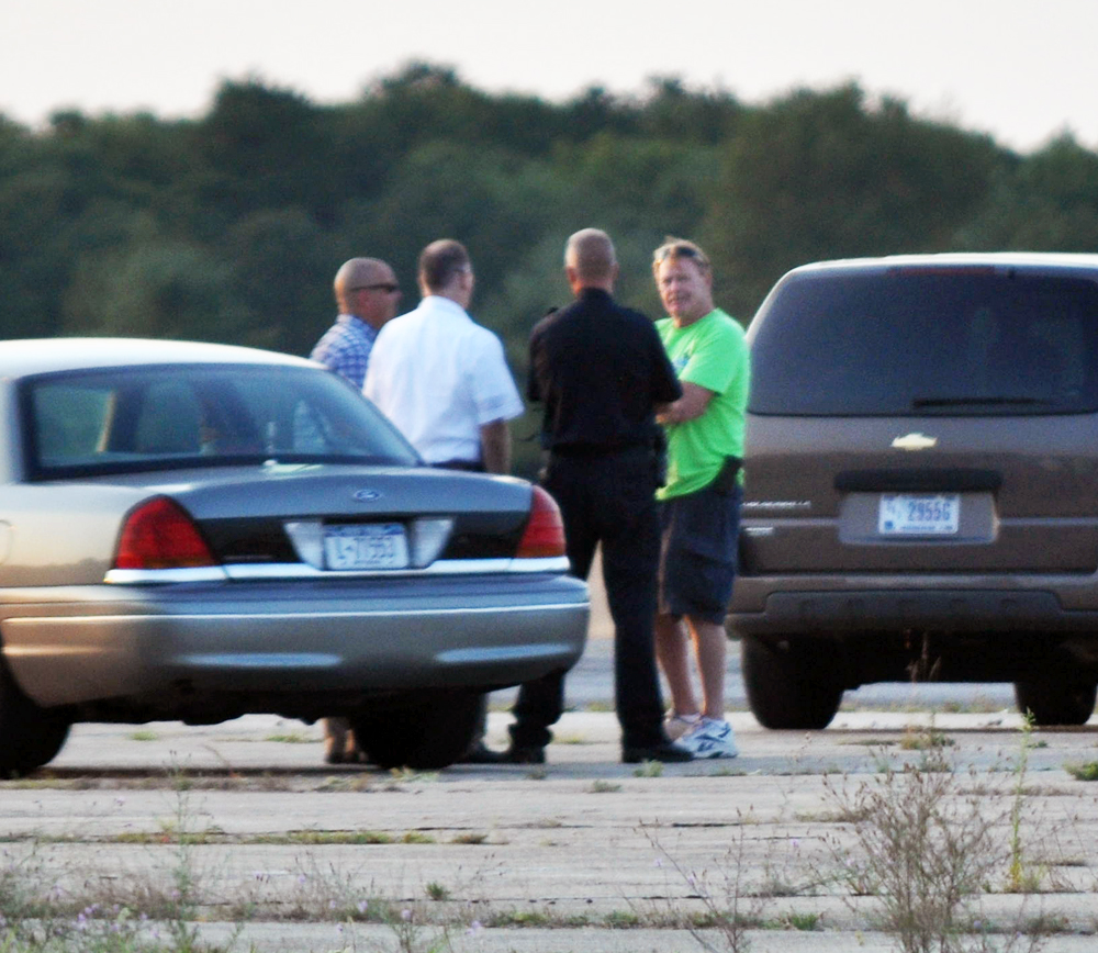 Skydive Long Island owner Ray Maynard speaks with investigators at the scene Wednesday evening. (Credit: Grant Parpan)