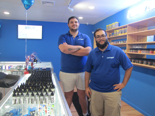 Employees Sam Leibowitz and Phil Brito inside Real Vapor, Riverhead's first e-cigarette store, on Route 58