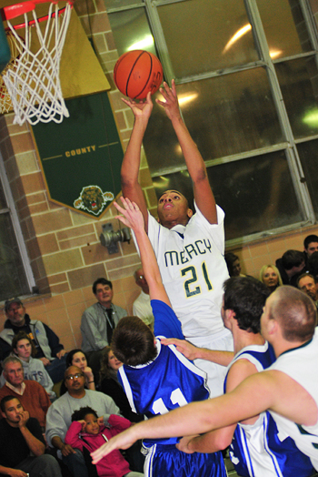 BILL LANDON PHOTO  |  McGann-Mercy sophomore Nykel Reese scored 17 points with 13 rebounds and 10 blocked shots Friday night against Mattituck.