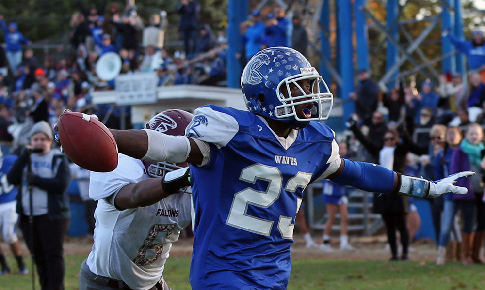 Riverhead wide receiver Steven Reid celebrates as he crosses into the endzone for a touchdown. (Credit: Daniel De Mato)