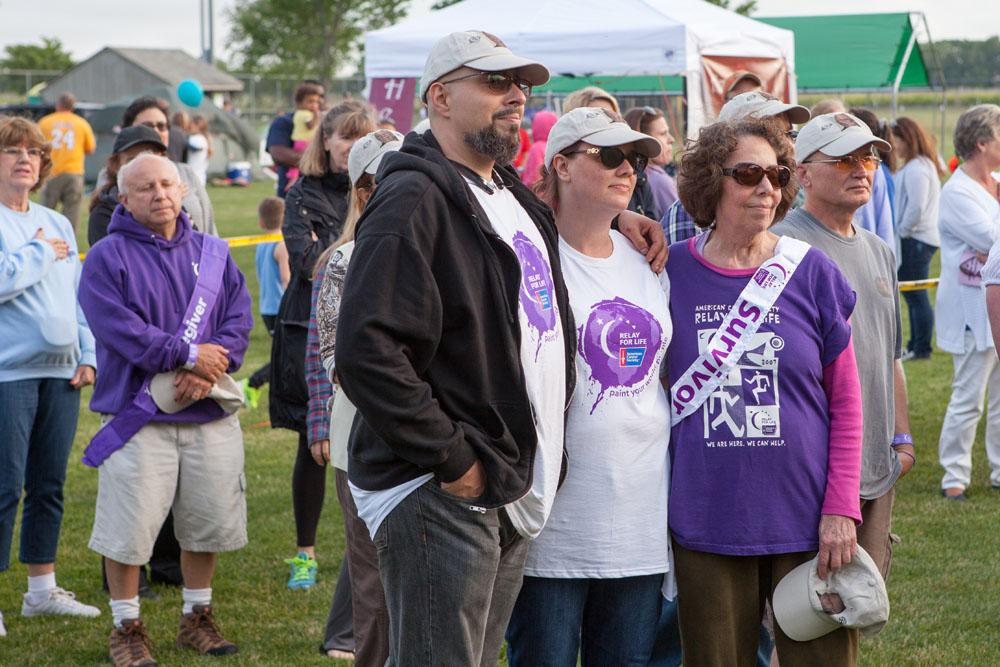 Survivors and their families watch the presentation. (Credit: Katharine Schroeder)