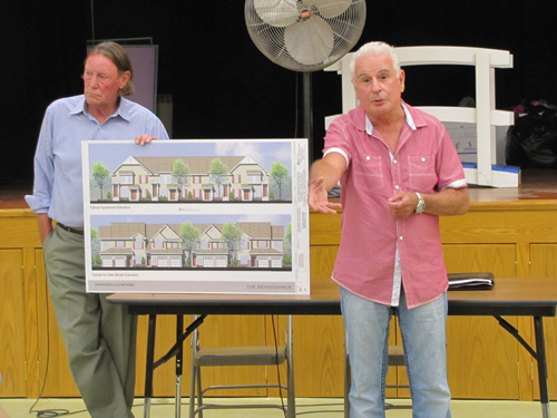 Builder Vincent DiCanio, right, explains his plans to the Calverton Civic Association as group president Rex Farr looks on