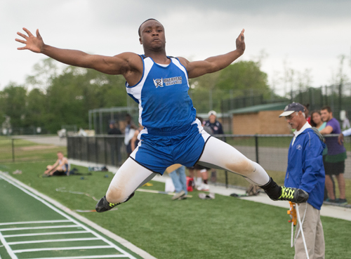 Riverhead sophomore Zikel Riddick jumped 20-11 1/4 in the long jump at the Division II Championship. (Credit: Robert O'Rourk)