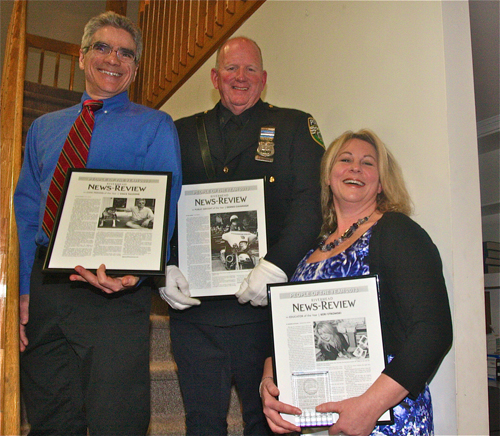 Civic Person of the Year Vince Taldone (left), Public Servant of the Year Dennis Cavanaugh and Educator of the Year Keri Stromski were honored Thursday night at the News-Review's main office in Mattituck.