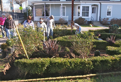 BARBARAELLEN KOCH FILE PHOTO | Riverhead Garden Club volunteers on East Main Street in 2011.