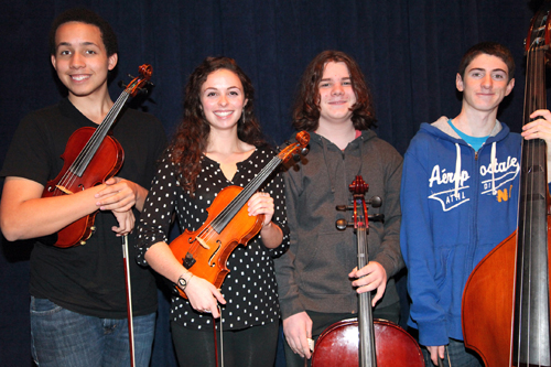 COURTESY PHOTO | From left, Riverhead High School students Matthew Barnard, Amy Methven, Aidan Saltini and David White have been selected to preform at this year's Long Island String Festival.