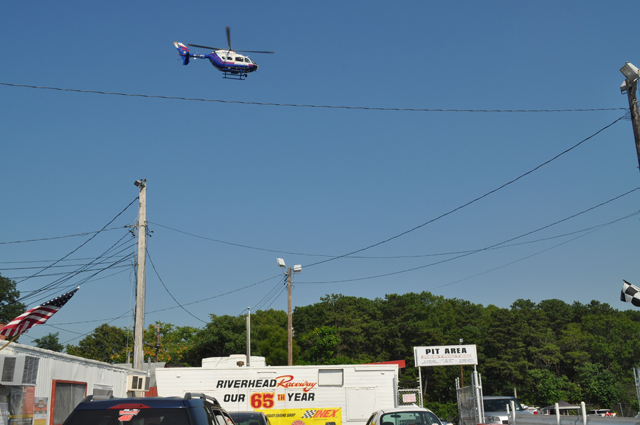 A police helicopter takes off for Stony Brook University Hospital from the track at Riverhed Raceway. (Credit: Grant Parpan)