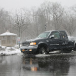 Several drivers plowed their trucks through the flooding downtown. (Credit: Paul Squire)