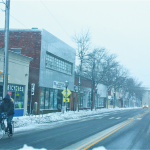 A lone bicyclist pedals past Twin Fork Bicycles on East Main Street. (Credit: Barbaraellen Koch)