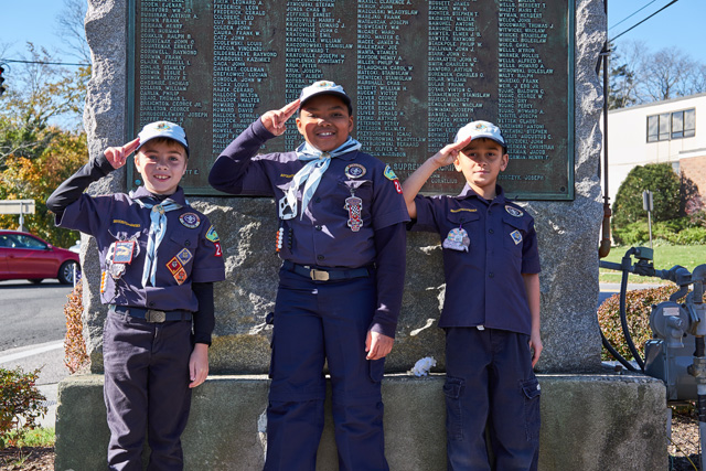 Lorenzo McFarlin, Miles Hatcher-Robertson and Edward Bedell of Cub Scouts Pack 242.