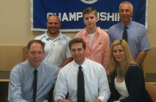 John Wendt III was flanked by his parents, John Jr. and Suzanne, during Friday's signing ceremony. Standing behind them, from left, are Riverhead coach Rob Maccone, Wendt's youngher brother, Riley, and Riverhead athletic director Bill Groth. (Credit: Bob Liepa)