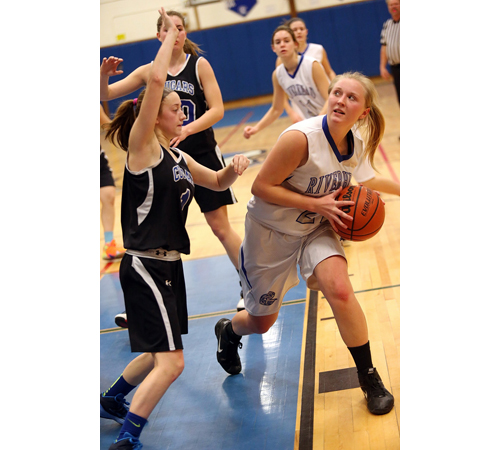 One of Riverhead's three seniors, Cassidy Brown, looks for shooting room while being guarded by Centereach's Alicia Indence. (Credit: Garret Meade)