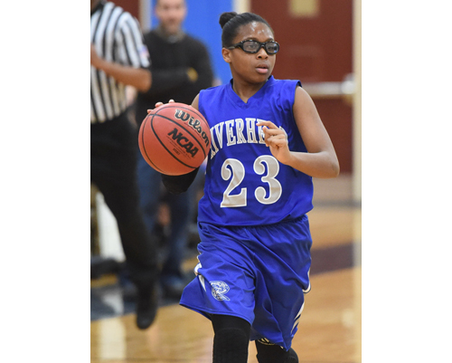 One of Riverhead's starting freshmen, Faith Johnson-DeSilvia, brought the Blue Waves 12 points and 8 rebounds against Eastport/South Manor. (Credit: Robert O'Rourk)