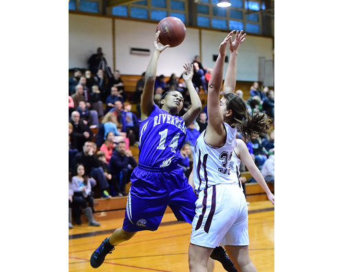 Riverhead's Kim Ligon flies toward the basket as King Park's Gianna Cancemi stands her ground. (Credit: Robert O'Rourk)