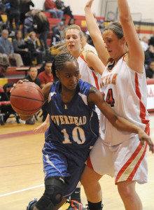 ROBERT O'ROURK PHOTO | Naysha Trent of Riverhead searching for dribbling room around Sachem East's Emily Carmel.