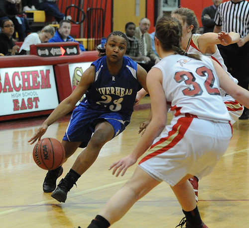 ROBERT O'ROURK PHOTO | Riverhead's Shanice Allen finds her path to the basket blocked by Sachem East's Sammy Drake.