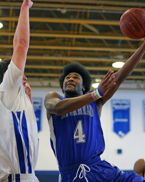 Tyrese Kerr #4 goes up for a shot in the first half against North Babylon. Riverhead was defeated by North Babylon by a score of 56-41 at North Babylon High School on Feb. 11, 2016.  on Feb 3, 2016.