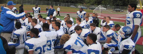 Riverhead football coach Leif Shay addressing his players following their win over Newfield Oct. 11. (Credit: Tim Gannon)