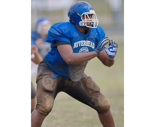Ethan Greenidge, a 6-foot-5, 320-pound lineman, is one of Riverhead's three all-division players. (Credit: Garret Meade)