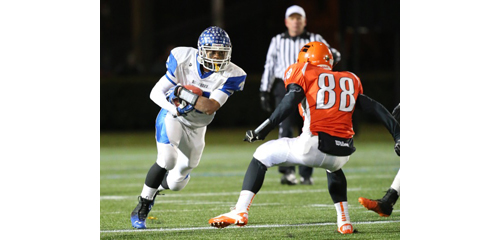 DANIEL DE MATO PHOTO | Riverhead's Jaron Greenidge runs for a first down before meeting up with Carey's Taylor Steinberg.