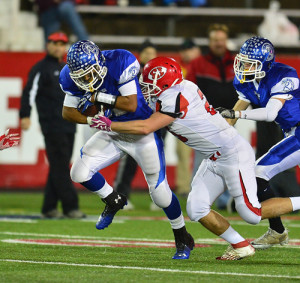 ROBERT O'ROURK PHOTO | Jeremiah Cheatom surges forward, bringing Riverhead yardage against East Islip.