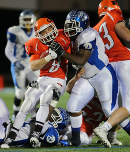 DANIEL DE MATO PHOTO | Carey running back Mike DeLeo is stopped by Riverhead defensive lineman Jonathan Lee for no gain.