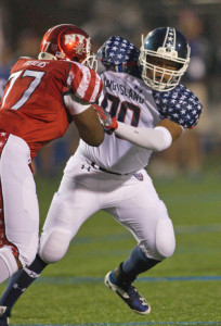 GARRET MEADE PHOTO | Riverhead's Nick Ross, fending off a block by New York City's Chad Vickers, played defensive end for the first time in two years.