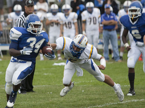 Riverhead's Raheem Brown evading West Islip's Joe Rushton during Saturday's season-opening game. (Credit: Katharine Schroeder)