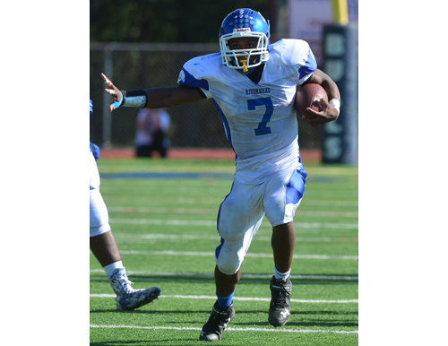 Riverhead's Ryun Moore ran the ball seven times for 55 yards against Smithtown West. (Credit: Robert O'Rourk)
