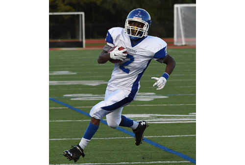 William Sanders of Riverhead running the ball against Half Hollow Hills West. (Credit: Robert O'Rourk)