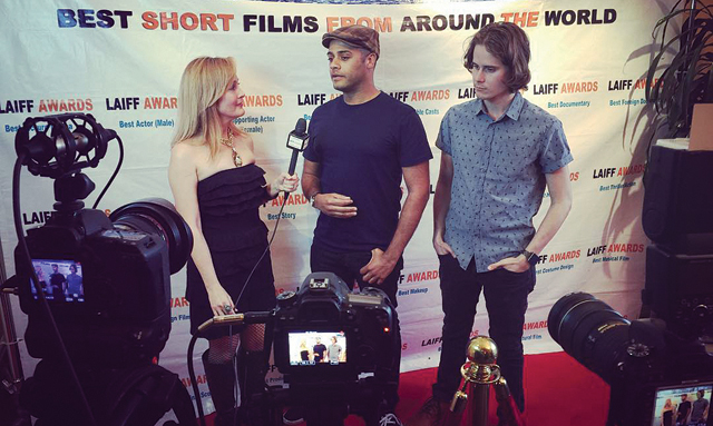 Marc Cartwright, center, is interviewed with his film's star on the red carpet. (Credit: Courtesy)