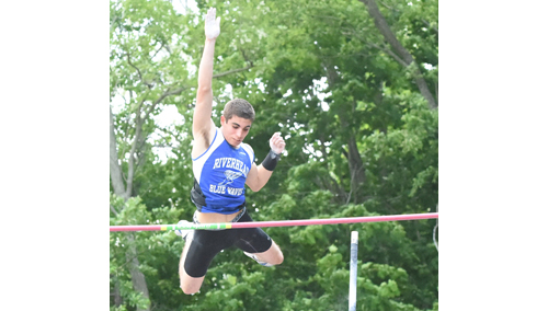 Riverhead pole vaulter Charles Villa clearing 14 feet en route to his triumph Friday at Port Jefferson High School. (Credit: Robert O'Rourk)