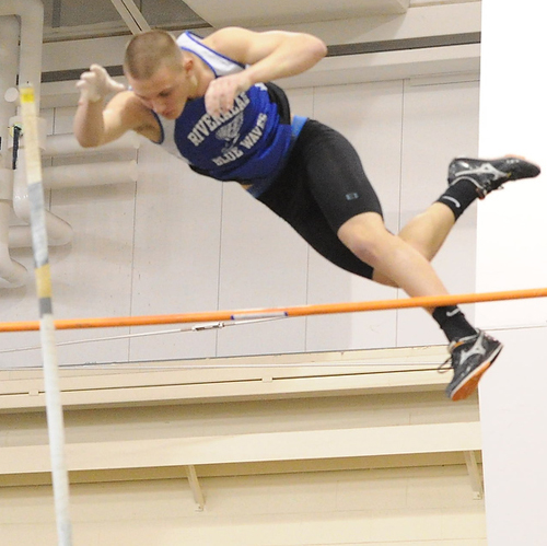 ROBERT O'ROURK PHOTO | Riverhead junior Dan Normoyle, one of three Blue Waves to pole vault 14 feet in the same meet, took first place in the Long Island Elite Track Invitational