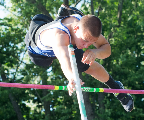 ROBERT O'ROURK PHOTO | Riverhead senior Dan Normoyle cleared 15 feet, breaking his own school record by 3 inches. He took first place while teammates Charles Villa (14-0) and Jonah Spaeth (14-0) were second and third, respectively.