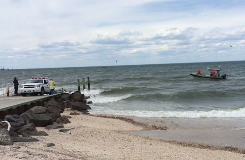 A police boat returns to the shore after officers were unable to locate a sailboat that had issued a distress call Sunday afternoon. The U.S. Coast Guard is continuing the search. (Credit: Grant Parpan)