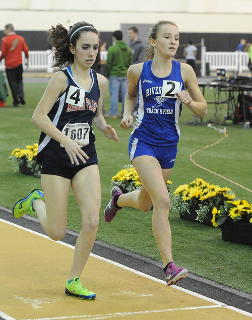 ROBERT O'ROURK PHOTO | Riverhead's Maria Dillingham, right, and Miller Place's Kiera Lopez running side by side in the 600 meters.