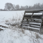 Unused pallets catch snow on Edwards Avenue in Calverton early Monday. (Credit: Paul Squire)