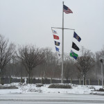 Wind and snow whip at a flagpole near the Peconic River. (Credit: Paul Squire)