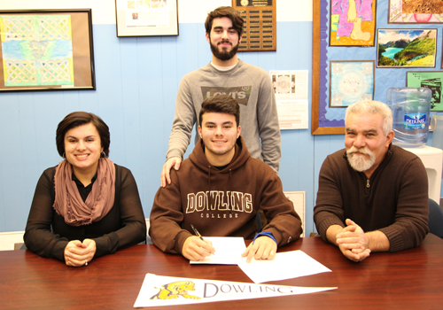 Riverhead senior forward Anthony Antunes signed a national letter of intent to play for Dowling College. Joining him in the signing ceremony on Tuesday were his parents Rosa and Jose and his brother Kevin. (Credit: Sandra Kolbo, courtesy)
