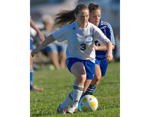 GARRET MEADE PHOTO | Meagan Brunner of Riverhead dribbling into space during Tuesday's match against Centereach.