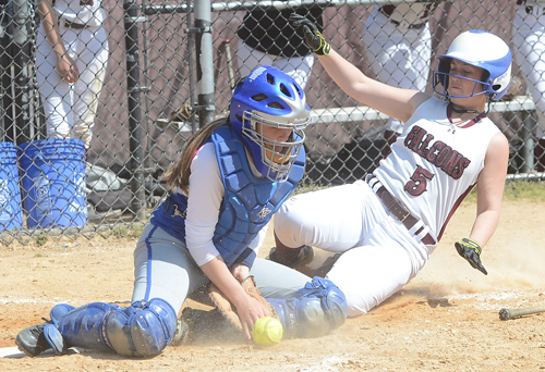 ROBERT O'ROURK PHOTO | Riverhead catcher Megan Weiss receiving a throw as Sydney Bernard scores for Deer Park on a close play at home plate.