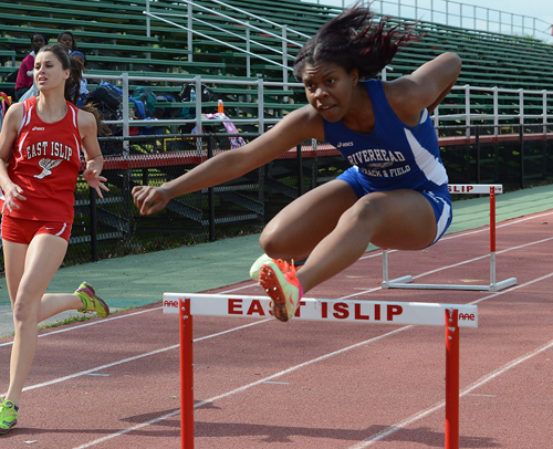ROBERT O'ROURK PHOTO | Denise Brunskill of Riverhead took first place in the 100-meter high hurdles in 17.9 seconds.