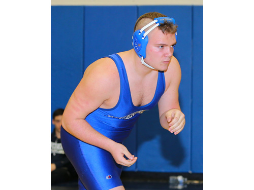 Charles Zaloom of Mattituck (black) defeated Justin Hansel of Riverhead (blue) in the 220 lbs finals of the North Fork Invitational which was held at Mattituck High School on Jan. 31, 2016.